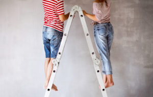 A couple is painting. They are feeling happy after starting online marriage counseling in Forest Hills, NY with Deborah Karnbad and online therapy in New York 11375